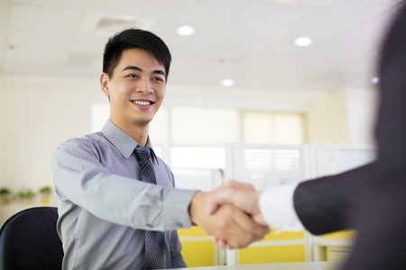 business man hand shaking in office photo