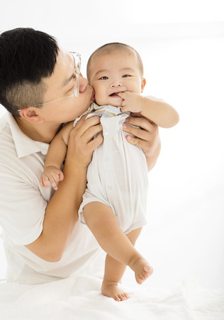 happy father with smiling baby boy Stock Photo