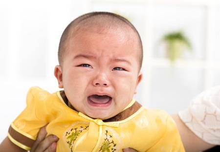 closeup crying asian baby boy