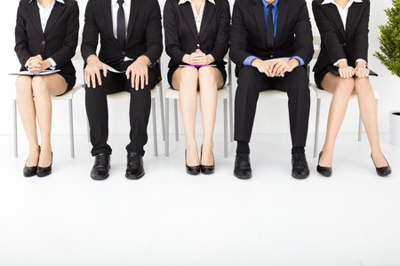 company job: nervous business people waiting for interview