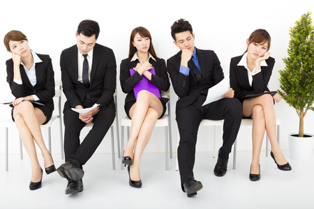 tired businessman: bored business people waiting for interview Stock Photo