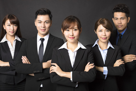 businesswoman suit: young businesswoman with successful business team