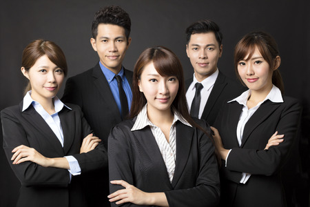 team leader: young businesswoman with successful business team
