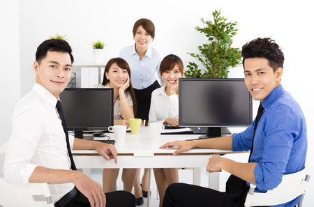 discussions: happy business people working in the office Stock Photo