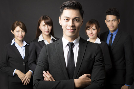 female boss: young businessman with successful business team