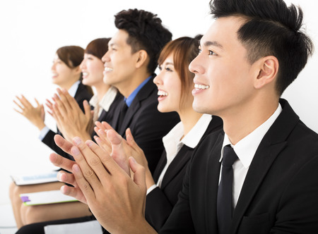 applaud: Business people sitting in a row