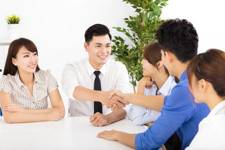 business asia: Business people shaking hands at a meeting