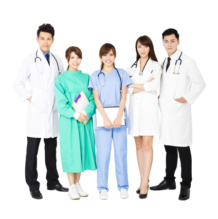 standing together: smiling Medical team standing together isolated on white Stock Photo