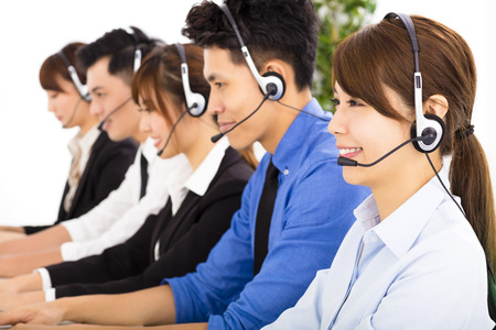 contact center: young business people and colleagues working in  call center