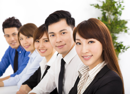 asian girl face: young business people working together at  meeting