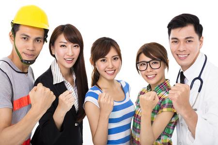 성공 제스처와 다른 직업의 다양한 젊은 사람들의 그룹 스톡 콘텐츠