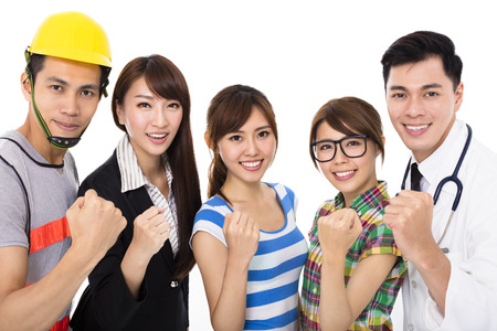Group of diverse young people in different occupations with success gesture