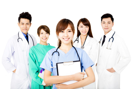 smiling Medical team standing together isolated on white 스톡 콘텐츠