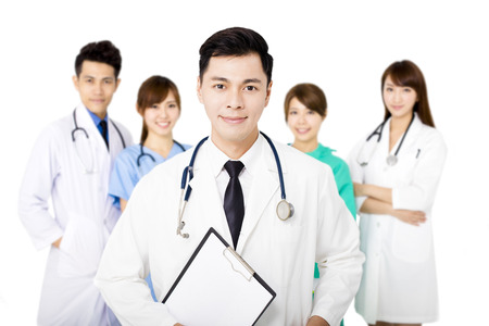 asian hospital: smiling Medical team standing together isolated on white Stock Photo