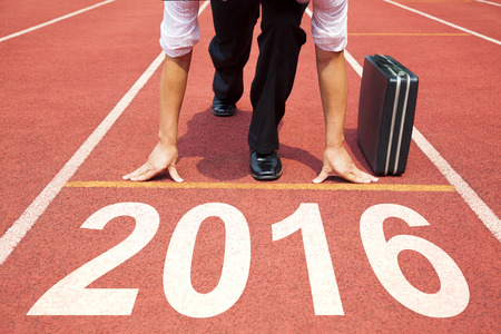challenging: businessman  ready to run and 2016 new year concept Stock Photo