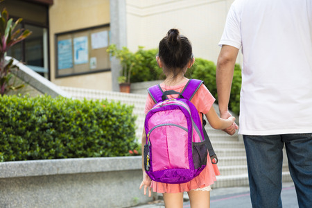 going: Father Walking To School With Children Stock Photo