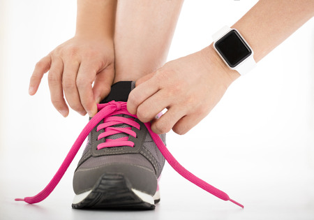 runner: closeup Running shoes and runner sports smartwatch Stock Photo