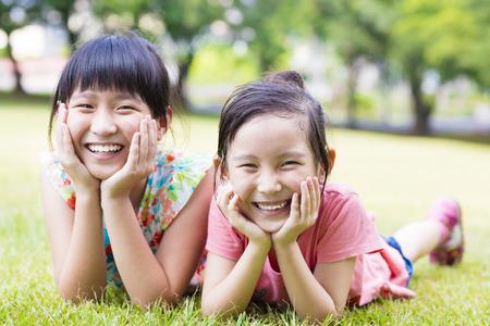 joy: closeup happy little girls on the grass Stock Photo