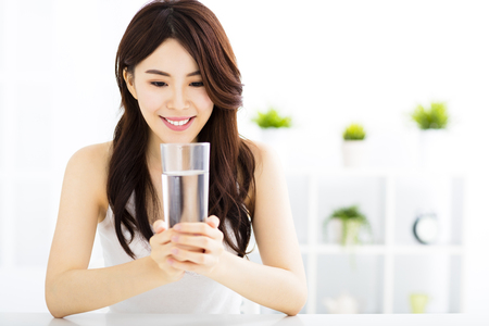 Young attractive woman with clean water