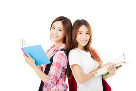 estudiantes: Feliz de dos estudiantes adolescentes niñas aisladas en blanco