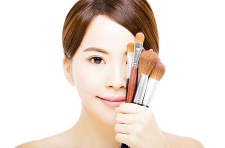 young beautiful woman with Makeup Brush Stock Photo