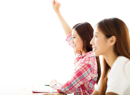 happy young student  raised hands in class