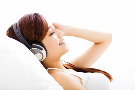 headphones: relaxed young Woman with headphones listening music