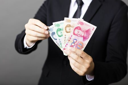 rmb: businessman holding yuan RMB in his hands