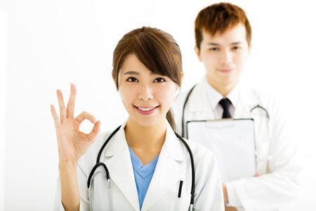 doctor female: smiling female doctor with ok gesture