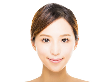 female face closeup: beautiful young smiling  woman with clean face