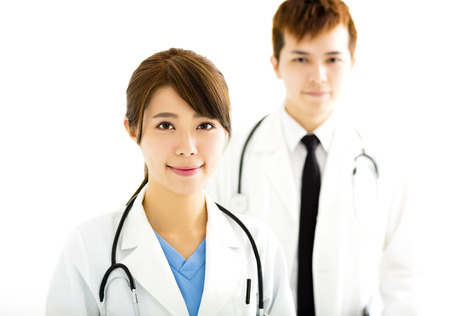 doctors smiling: smiling male and female doctors standing together
