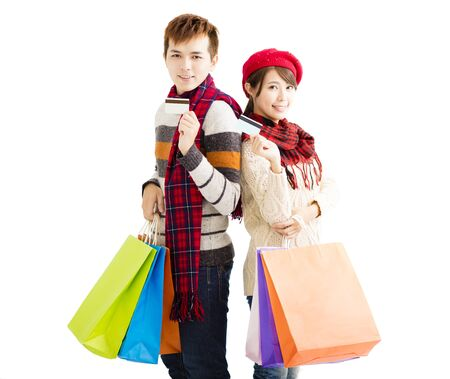 shopping card: young couple with shopping bags and credit card Stock Photo