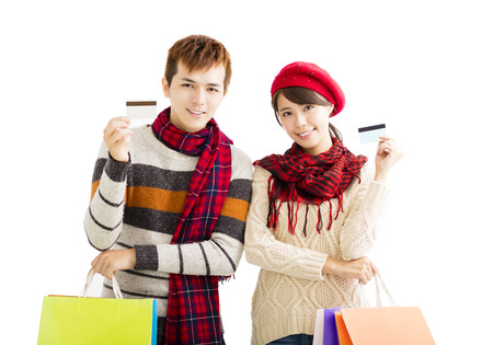 man holding card: young couple with shopping bags and credit card Stock Photo