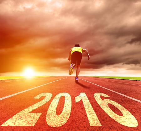 sunrise: happy new year 2016. young man running with sunrise background Stock Photo