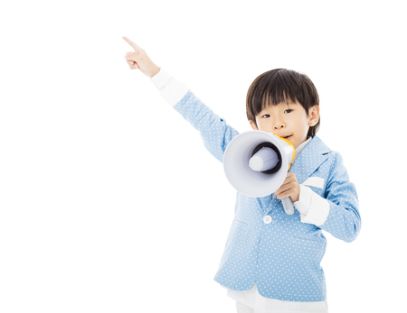 screaming: little boy shouting in megaphone isolated