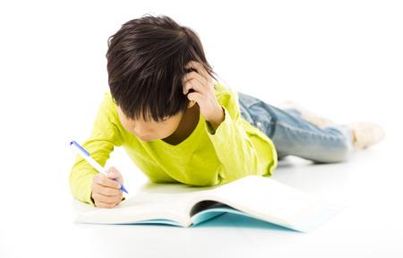joy of reading: Little boy study on the floor