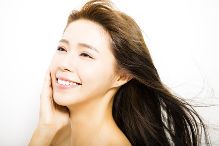 sexy asian woman: young Woman  with hair motion on white background