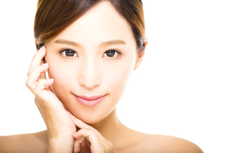 chinese face: beautiful young smiling  woman with clean face