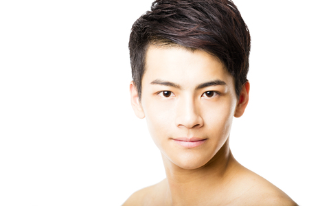 asian style: Closeup portrait of attractive young man face Stock Photo