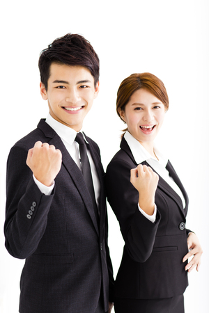 happy business man and woman standing  in office Imagens