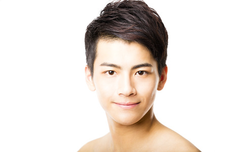 handsome young man: Closeup portrait of attractive young man face Stock Photo