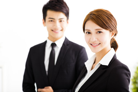 charming business lady: happy business man and woman standing  in office Stock Photo