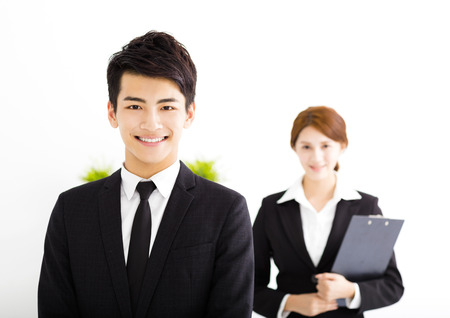asia women: happy business man and woman standing  in office Stock Photo