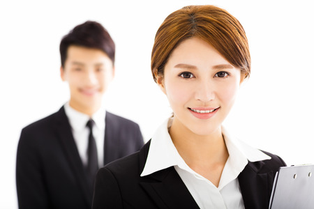 confident business woman: happy business man and woman standing  in office Stock Photo