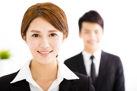 two companies: happy business man and woman standing  in office Stock Photo
