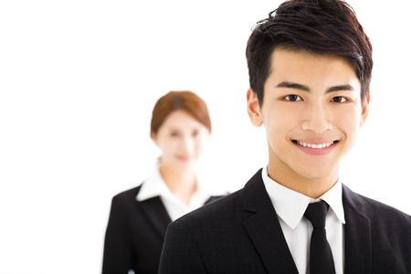 asian group: happy businessman and woman standing  in office