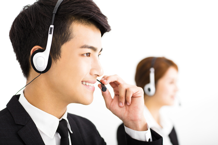centre: young business people working with headset in office