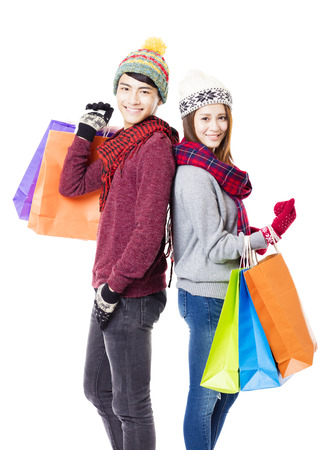 winter people: happy couple shopping together with winter wear