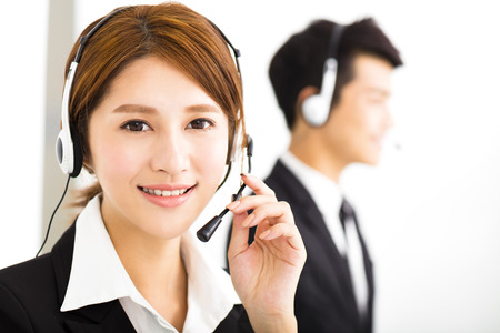 customer support: young business people working with headset in office