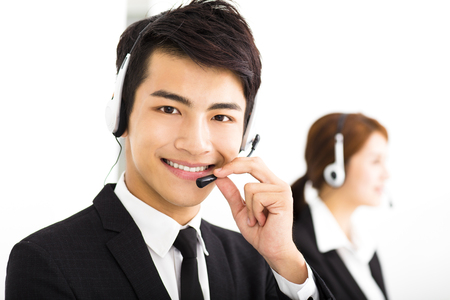 service desk: young business people working with headset in office